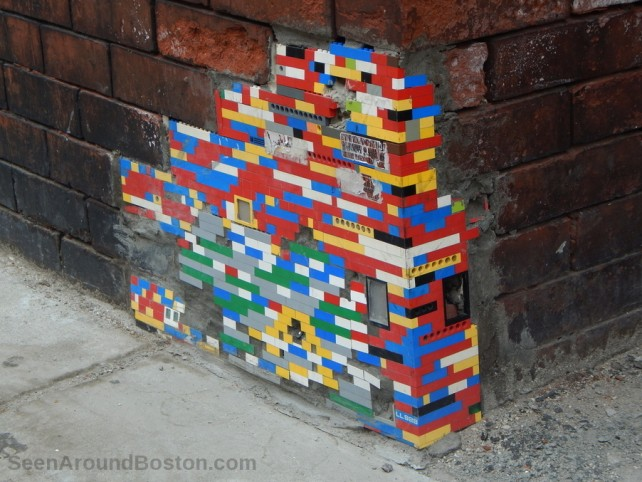 Lego blocks to patch up a broken brick building in Boston