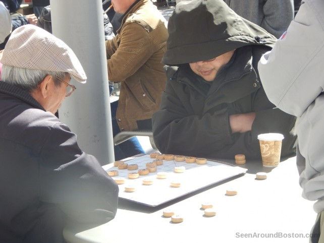 old men playing Xiangqi in Boston's Chinatown